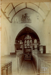Photograph of nave, St.Mary's Lydiard Tregoze, with Royal Arms mounted above the chancel arch, 1896