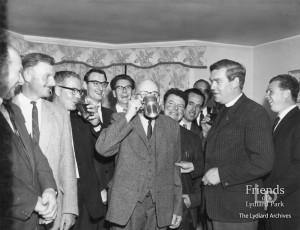 Photograph of Revd. Brian Carne & local men celebrating, c1965